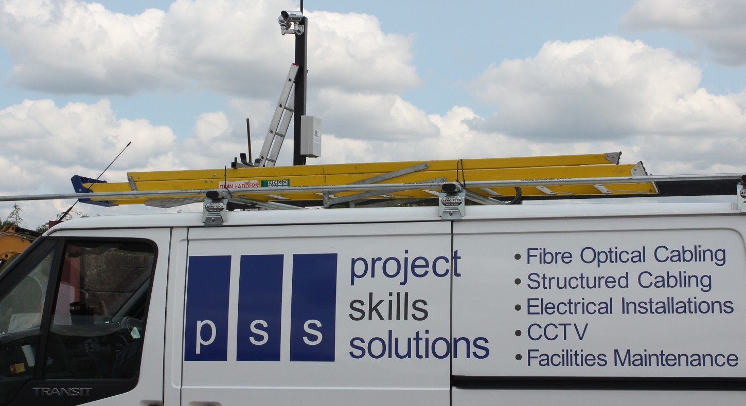 Project Skills Solutions van on industrial site - CCTV being installed on pole