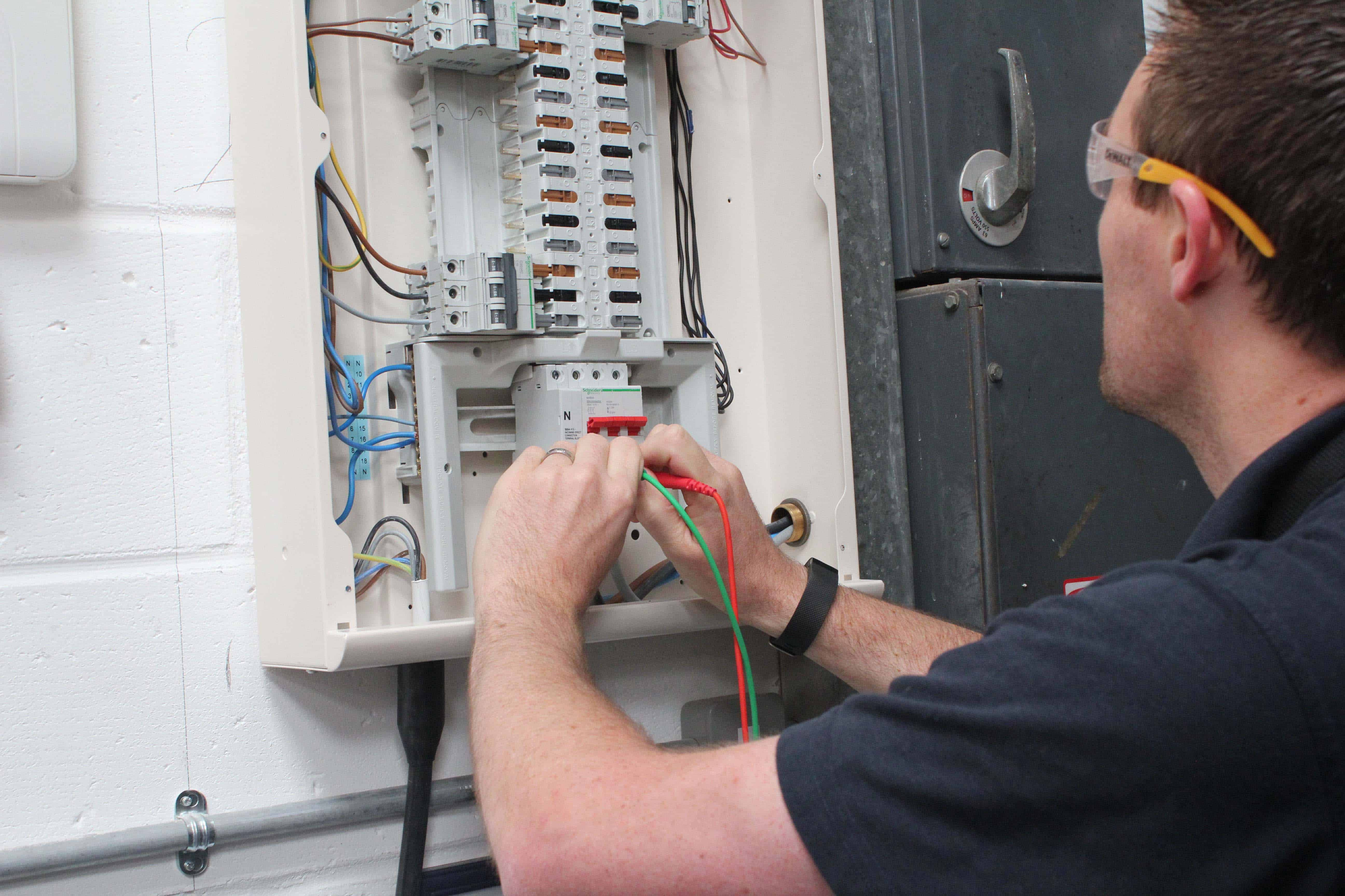 Electrical testing and fixed wire inspection services. Engineer performing electrical test.