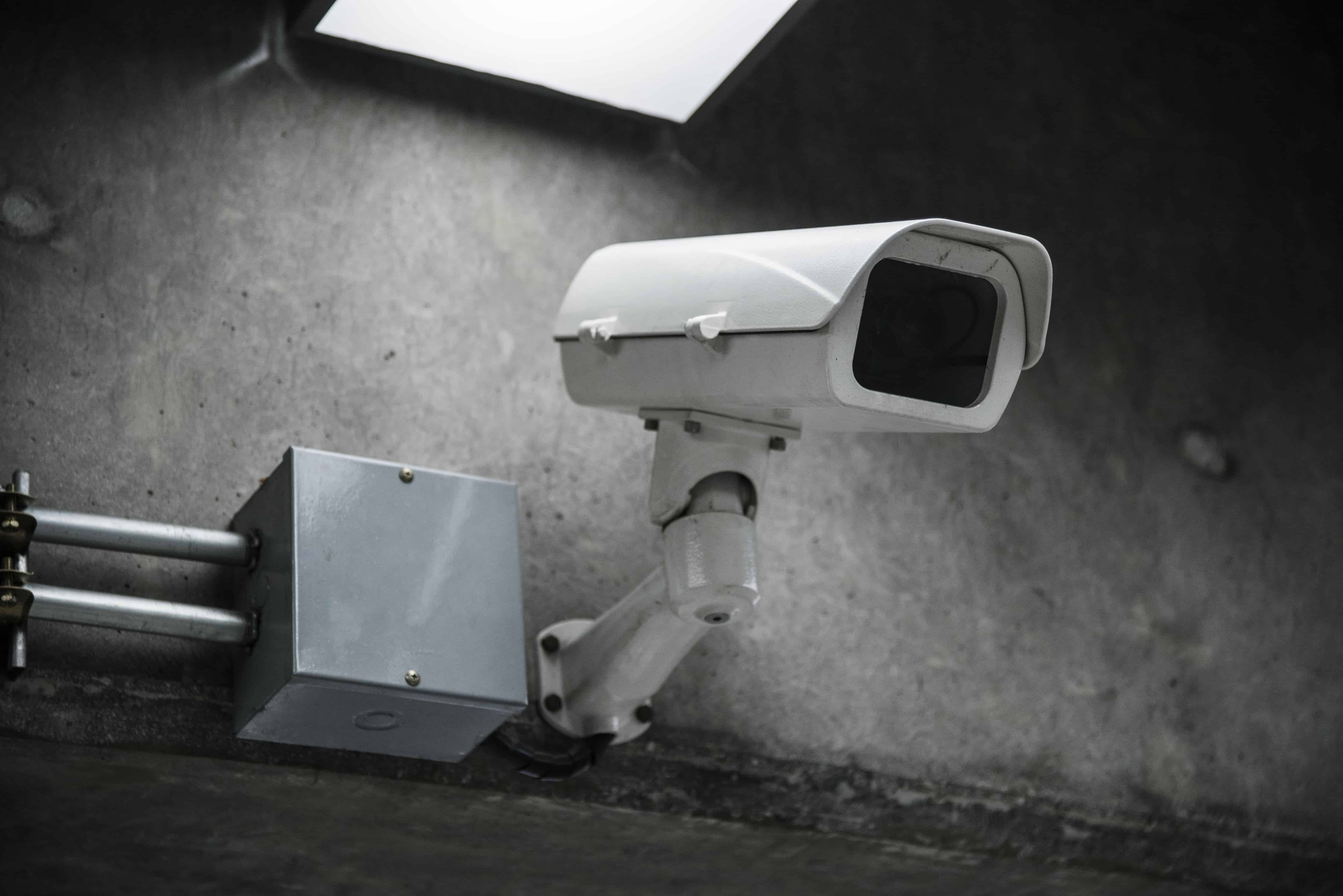 An image of a CCTV camera closeup, on the wall.