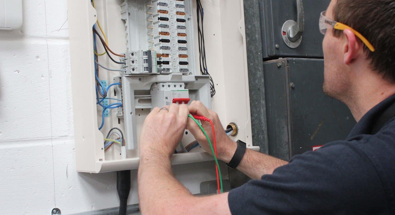 Engineer testing a fuse board.