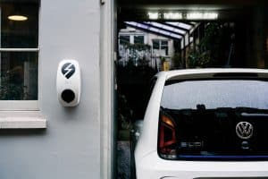 car next to ev charging point