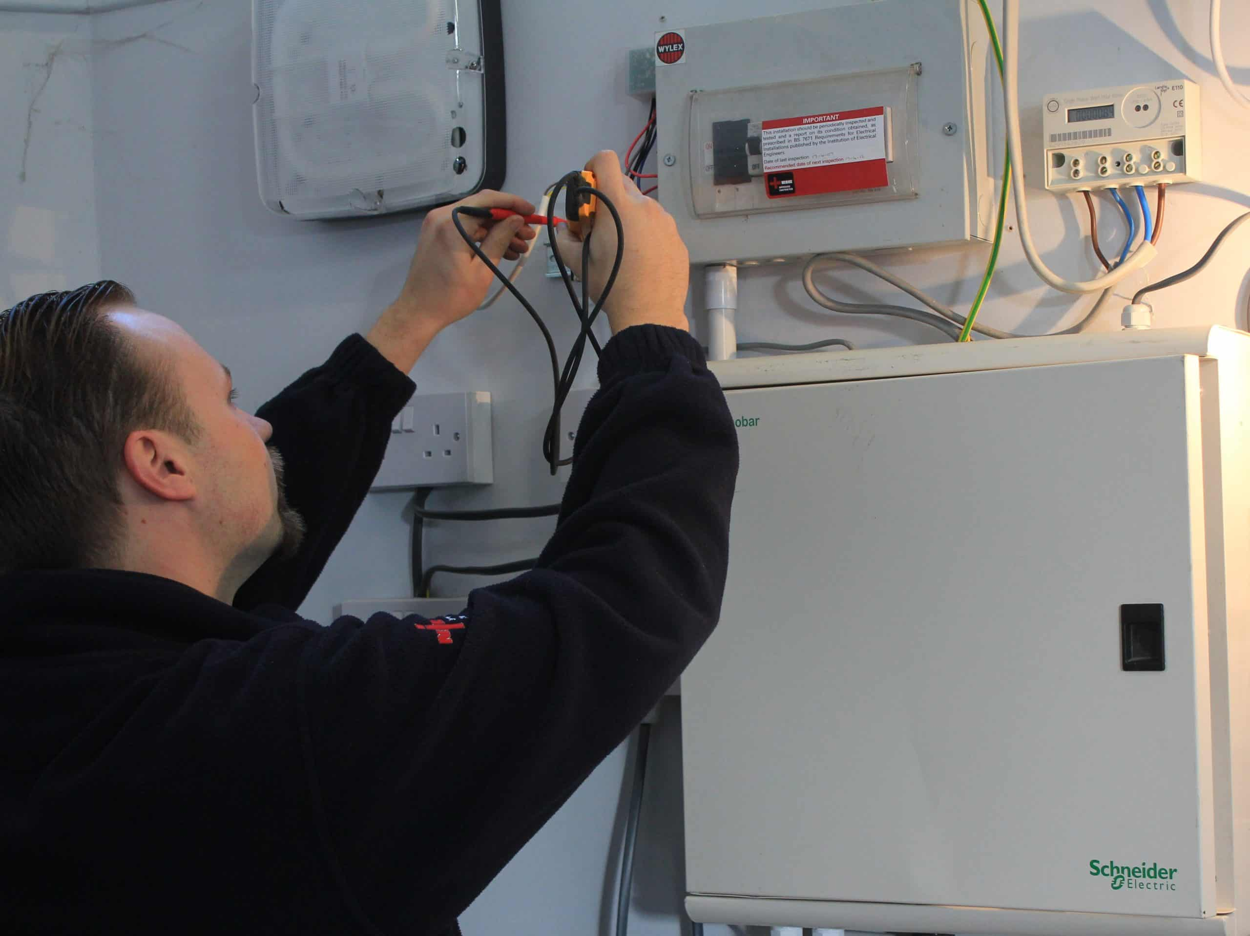 Electrical testing being carried out by qualified electrician