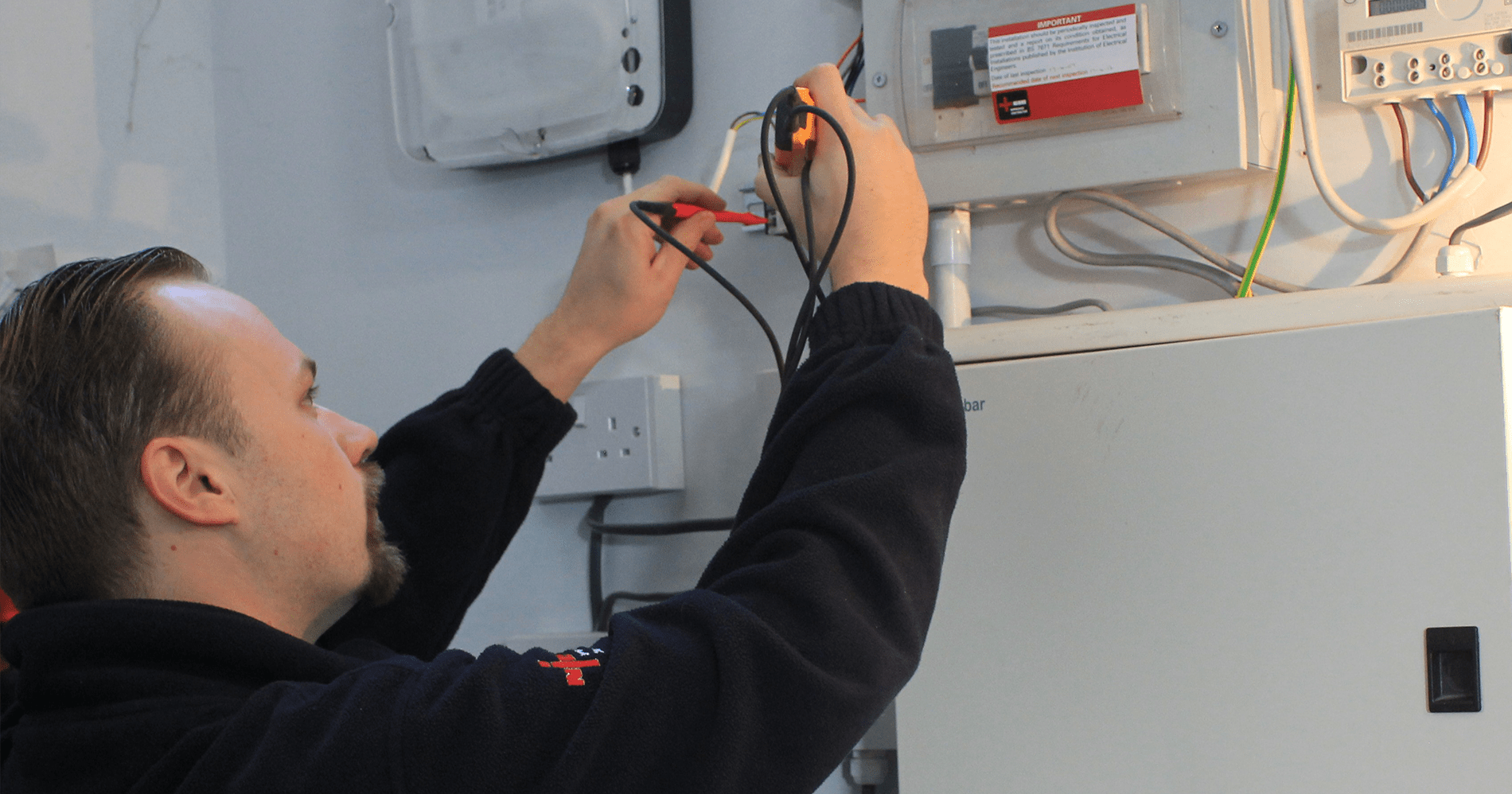 Image of a man carrying out the EICR Test Procedure