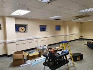 Electrician installing dado trunking